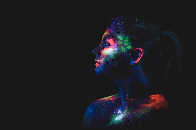 Portrait of a girl painted in fluorescent uv colors. Premium Photo