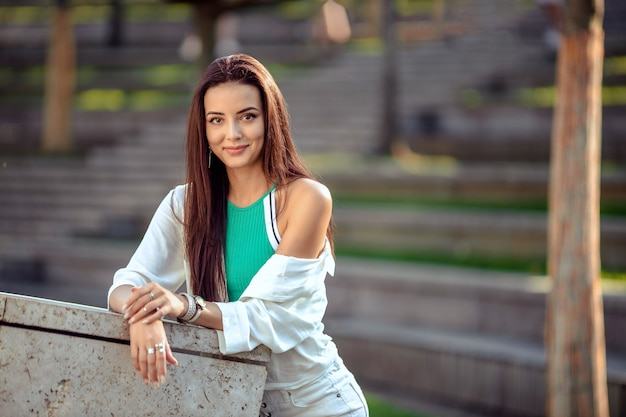 Portrait of a girl in sportswear for a walk in the park Premium Photo