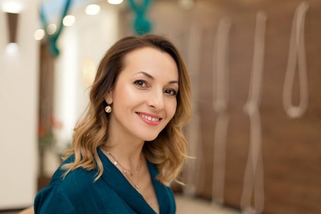 Portrait of gorgeous woman yoga trainer posing in for yoga classes Premium Photo