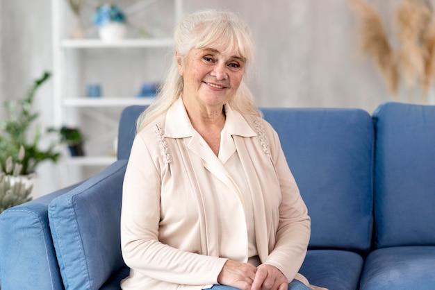 Portrait grandma on couch Free Photo
