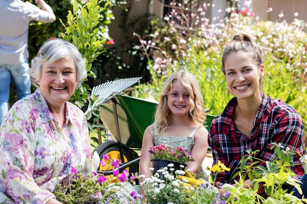 Portrait of grandmother, mother and daughter gardening together Premium Photo