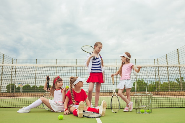 Portrait of group of girls as tennis players holding tennis racket Free Photo
