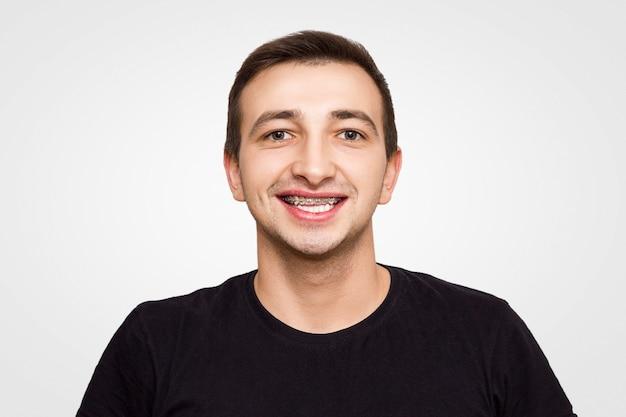 Portrait of a guy in a black t-shirt in braces Premium Photo