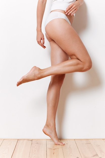 Portrait of a half of sexy female body in underwear Free Photo