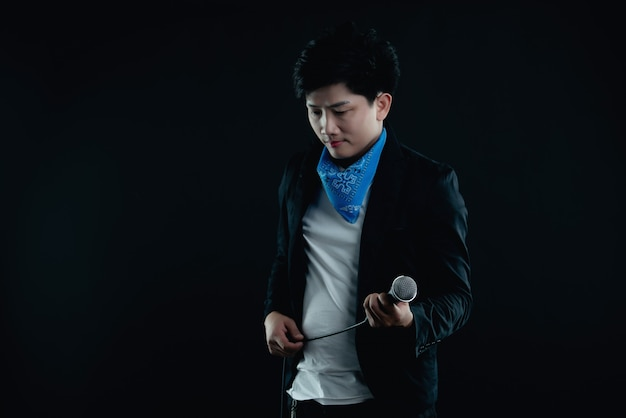 Portrait of handsome attractive singer Free Photo