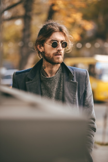 Portrait of a handsome bearded man in sunglasses Free Photo