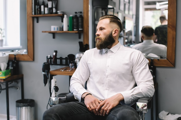 Portrait Of Handsome Bearded Man With Fashionable Hairstyle And