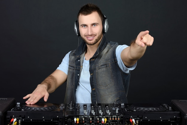 Portrait of handsome deejay playing club music. Premium Photo