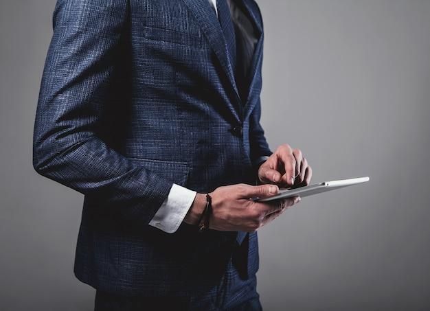 Portrait of handsome fashion businessman model dressed in elegant blue suit Free Photo