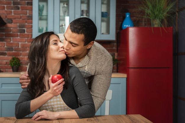 Portrait of handsome man kissing woman Free Photo