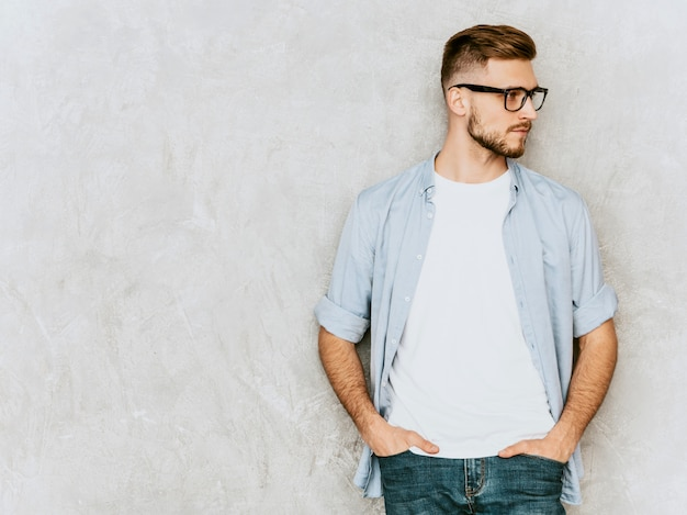 Portrait of handsome serious young man model wearing casual shirt clothes. fashion stylish man posing in spectacles Free Photo