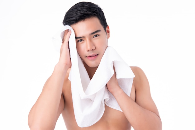 Premium Photo | Portrait of handsome young asian man isolated. concept of  men's health and beauty, self-care, body and skin care.