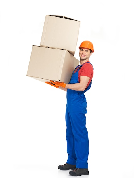Portrait of handsome young delivery man with paper boxes isolated on white Free Photo