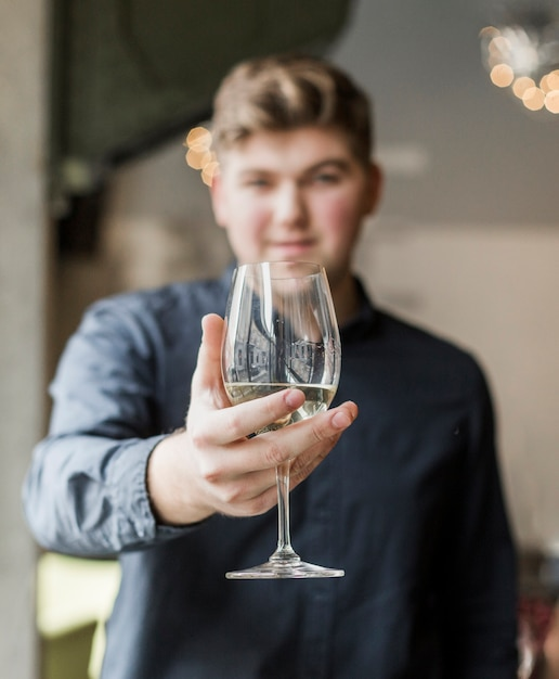 Portrait of handsome young man holding a drink Free Photo