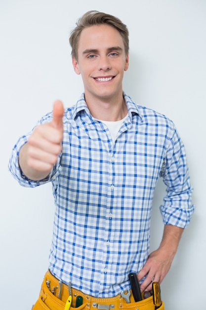 Portrait of a handyman gesturing thumbs up Premium Photo