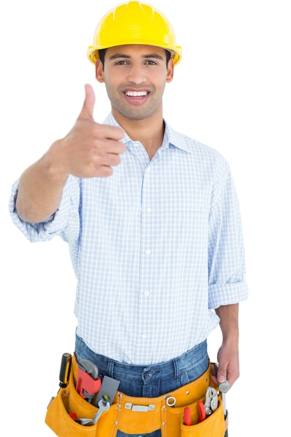 Portrait of a handyman in yellow hard hat gesturing thumbs up Premium Photo