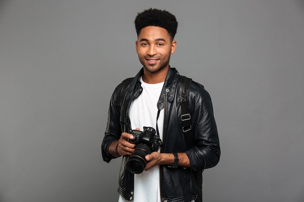 Portrait of a happy afro american guy in leather jacket Free Photo