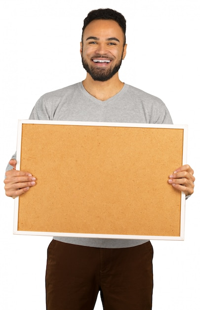Portrait of a happy afro american man holding blank board isolated on a white Premium Photo