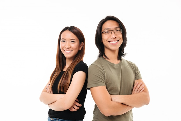 Portrait of a happy attractive asian couple standing Free Photo