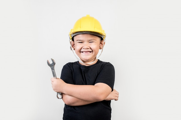 Portrait happy boy wearing engineer hat Free Photo