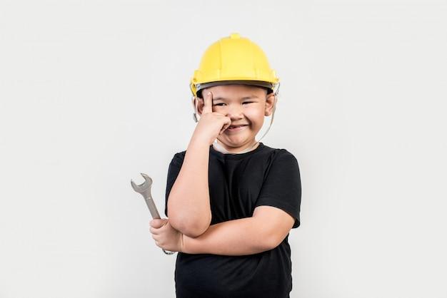 Portrait happy boy wearing engineer hat Free Photo