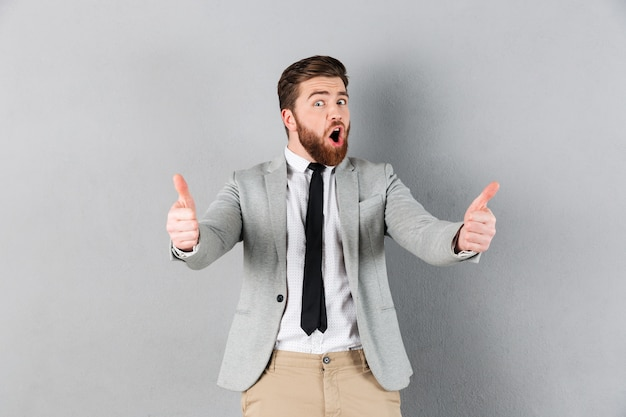 Portrait of a happy businessman dressed in suit Free Photo