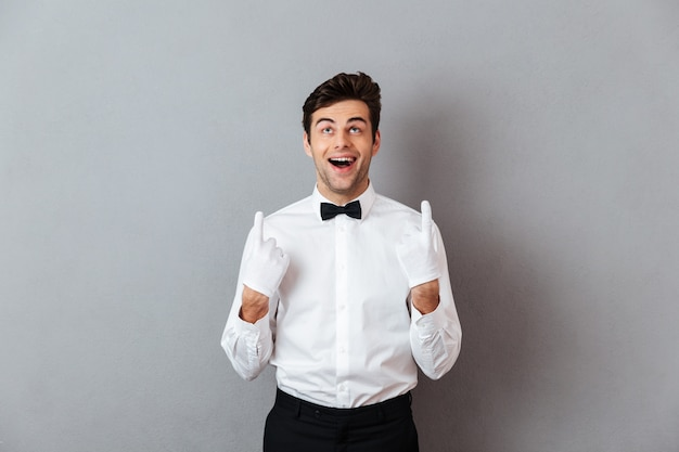 Portrait of a happy cheerful male waiter Free Photo