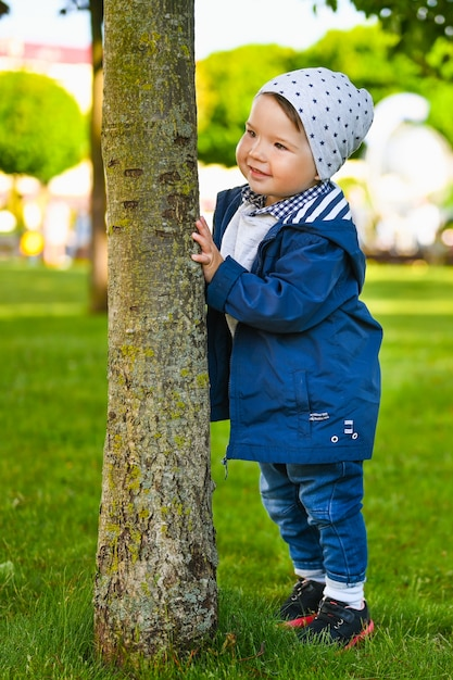Portrait of a happy child playing outside in sunny weather Premium Photo