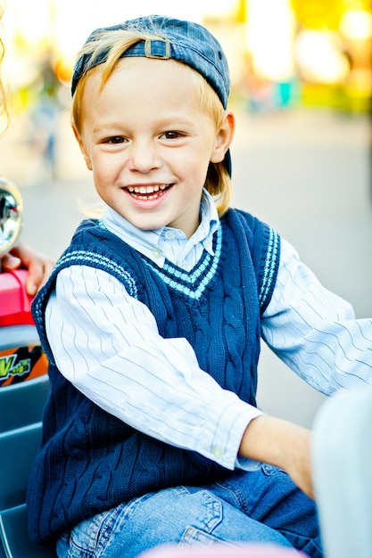 Portrait of happy childhood. stylish little boy in blue hat, sweater and shirt Free Photo