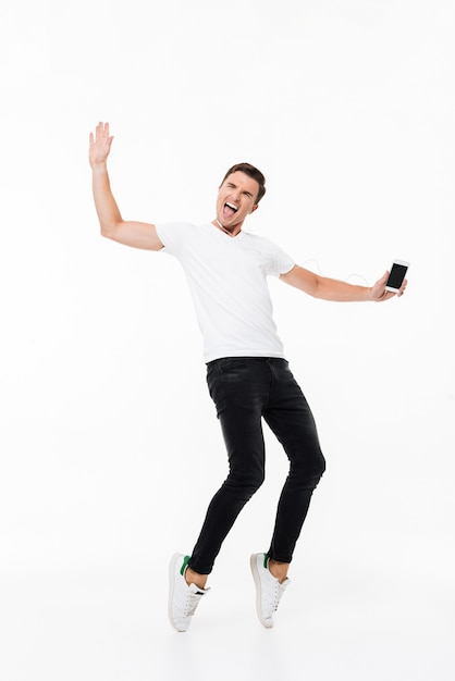 Portrait of a happy energetic man Free Photo