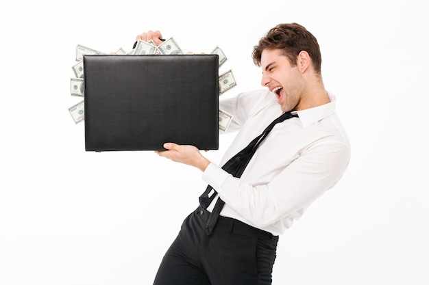 Portrait of a happy excited businessman Free Photo