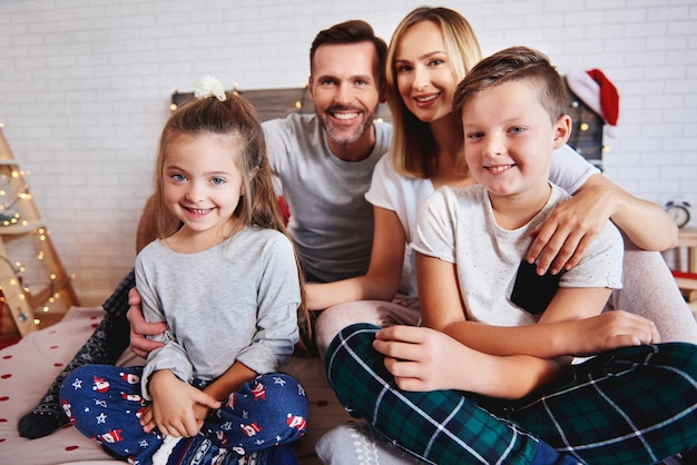 Portrait of happy family in bed at christmas Free Photo