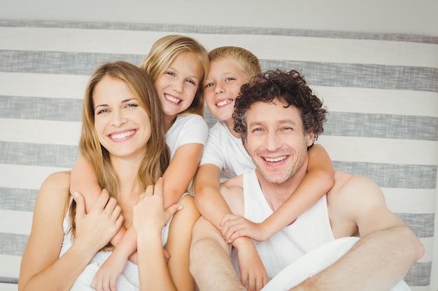 Portrait of happy family on bed Premium Photo