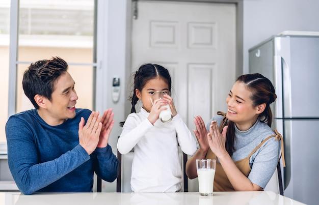 Premium Photo | Portrait of happy family drinking milk in the kitchen