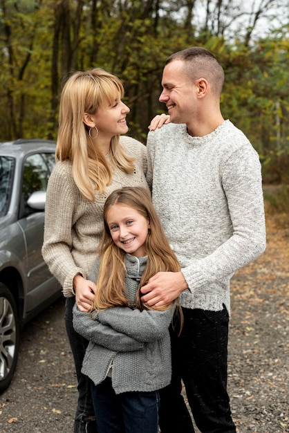 Portrait of happy family in nature Free Photo