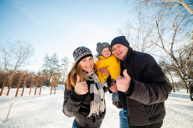 Portrait of happy family in winter park Premium Photo