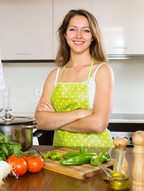 Portrait of happy girl cooking  at  kitchen Free Photo
