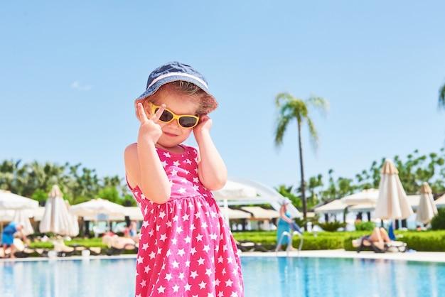 Portrait of a happy girl outdoors in summer day. amara dolce vita luxury hotel. resort. tekirova-kemer. turkey. Free Photo