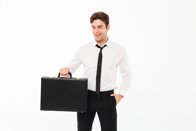 Portrait of a happy handsome businessman Free Photo