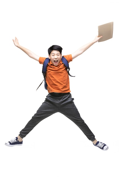 Portrait of happy little asian child jumping isolated on white Premium Photo
