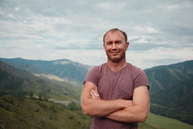 Portrait of a happy man on a mountain view Premium Photo