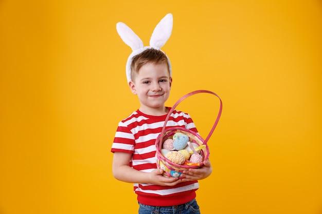 Portrait of a happy satisfied little kid wearing bunny ears Free Photo