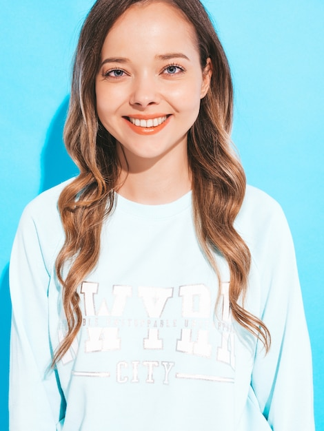 Portrait of of happy smiling girl with in casual clothes without makeup. young woman model posing Free Photo