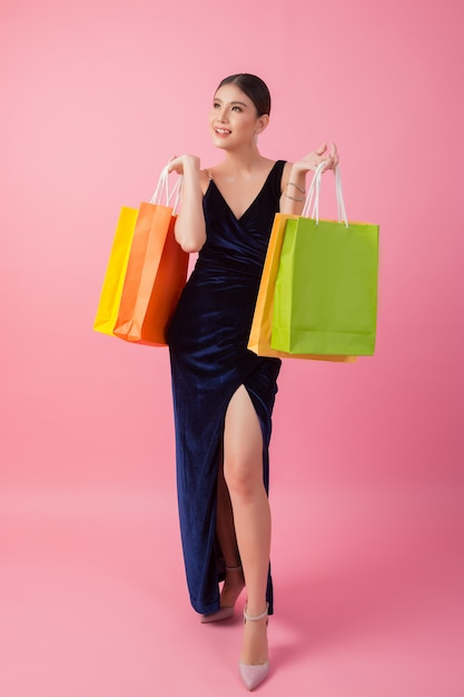 Portrait of happy smiling woman hold shopping bag Free Photo