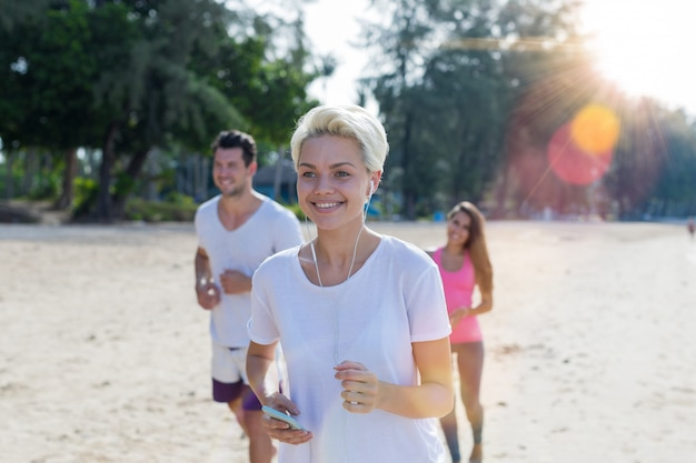 Portrait of happy smiling woman running on beach Premium Photo