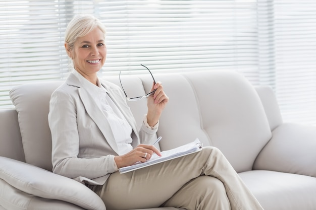 Portrait of happy therapist in office Premium Photo