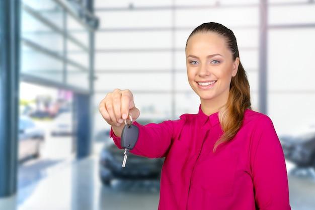 Portrait of happy woman holding a car key Premium Photo