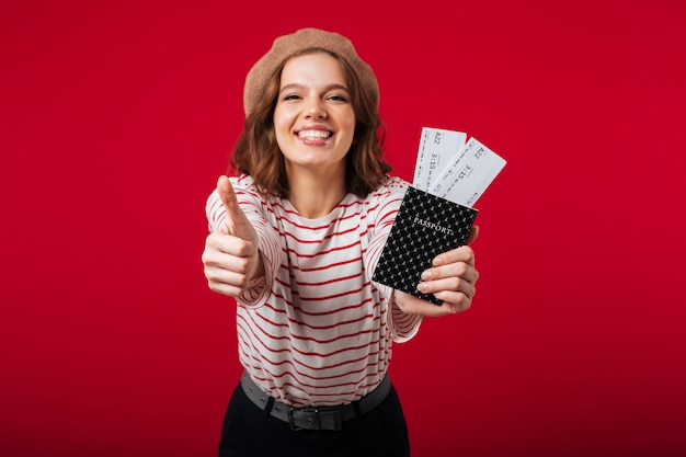 Portrait of a happy woman holding passport Free Photo