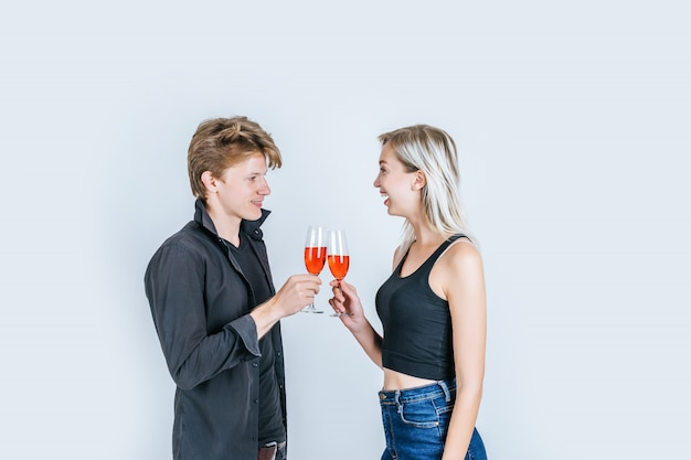 Portrait of happy young couple drinking wine Free Photo