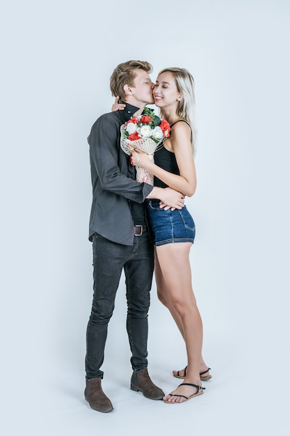 Portrait of happy young couple love together with flower Free Photo